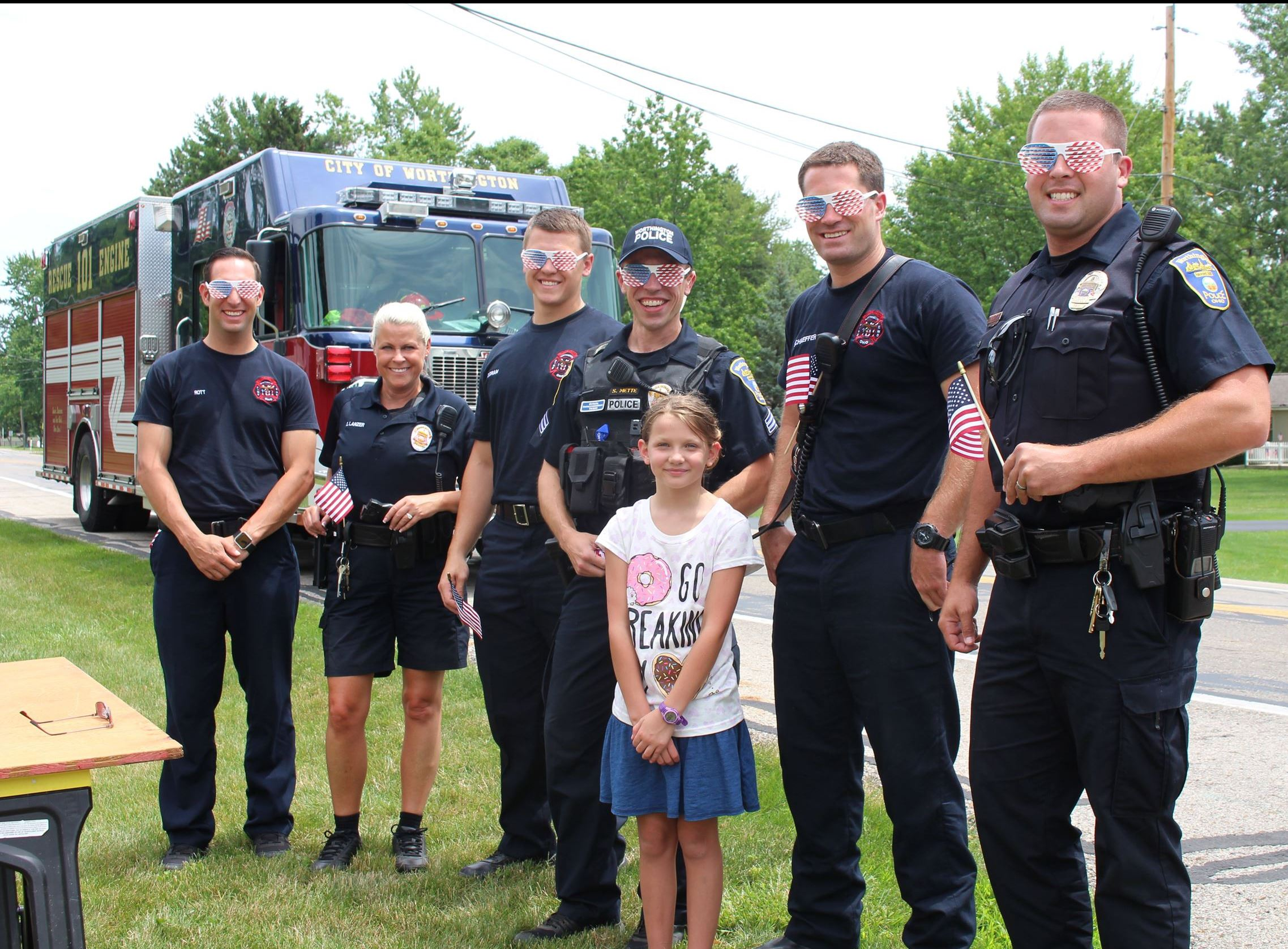 Officers and Firefighters at lemonade stand