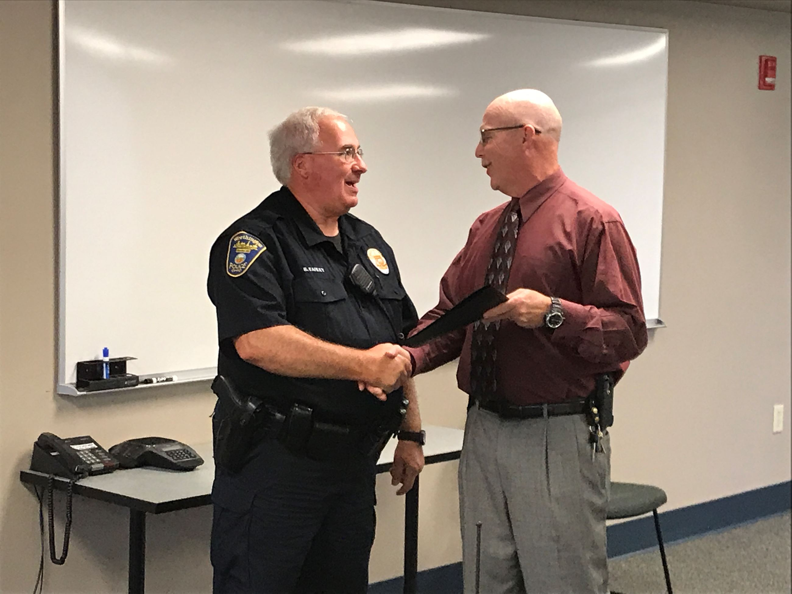 Ofc Earley gets an award from Chief Strait
