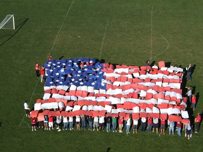 Citizens forming an American flag with paper