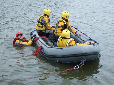 Firefighters in a raft