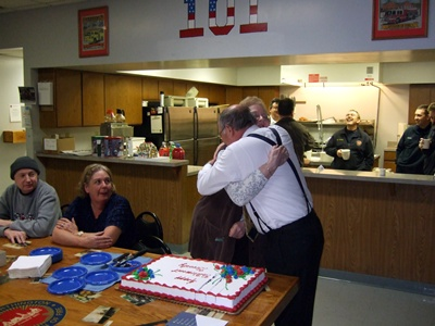 Two members hugging at a going away party