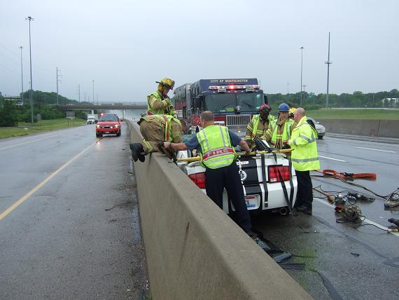 Firefighters helping with a car crash