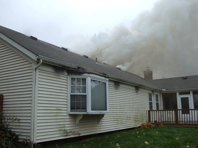 Smoke rising over a structure fire