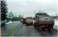 Trucks removing snow